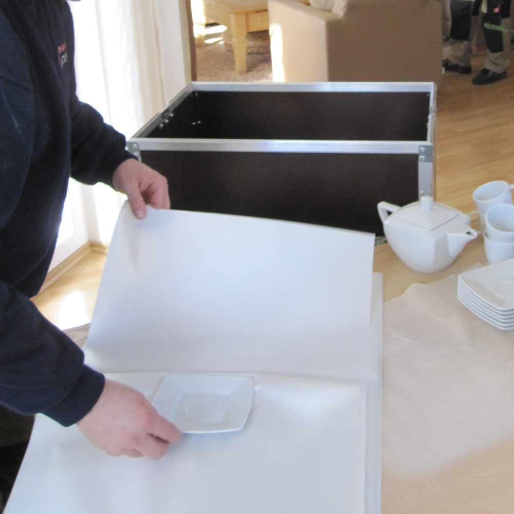 Geschirr sicher einpacken